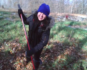 Student Sai Thao plants a tree in Detroit