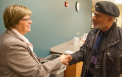 Metropolitan State Provost Ginny Arthur greets John Wright, Ph.D., before The Big Read kick-off event Jan. 28, 2016 at the Saint Paul Campus Library.