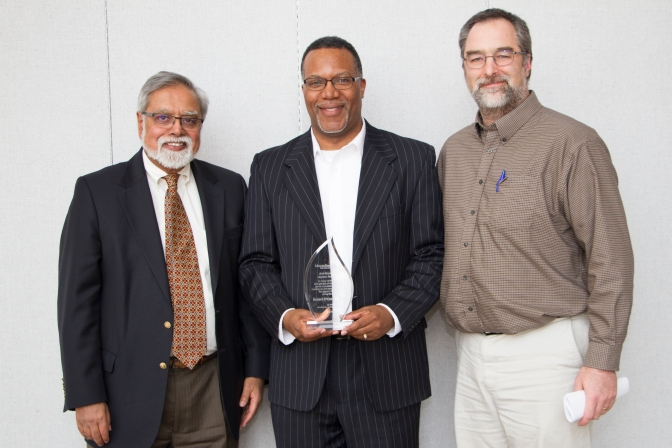 Interim President Devinder Malhotra, Robert O'Conner and Paul Spies at the Employee Awards