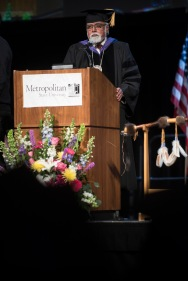 Interim President Devinder Malhotra speaking at commencement.