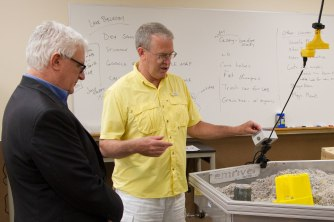 Associate professor John Schneider, right, explains how watersheds are studied during a tour of Metropolitan State University's Science Education Center for editorial board member Pat Effenberger and editor Mike Burbach of the Saint Paul Pioneer Press. Effenberger and Burbach visited the Saint Paul Campus to meet with incoming President Ginny Arthur, June 16, 2016.